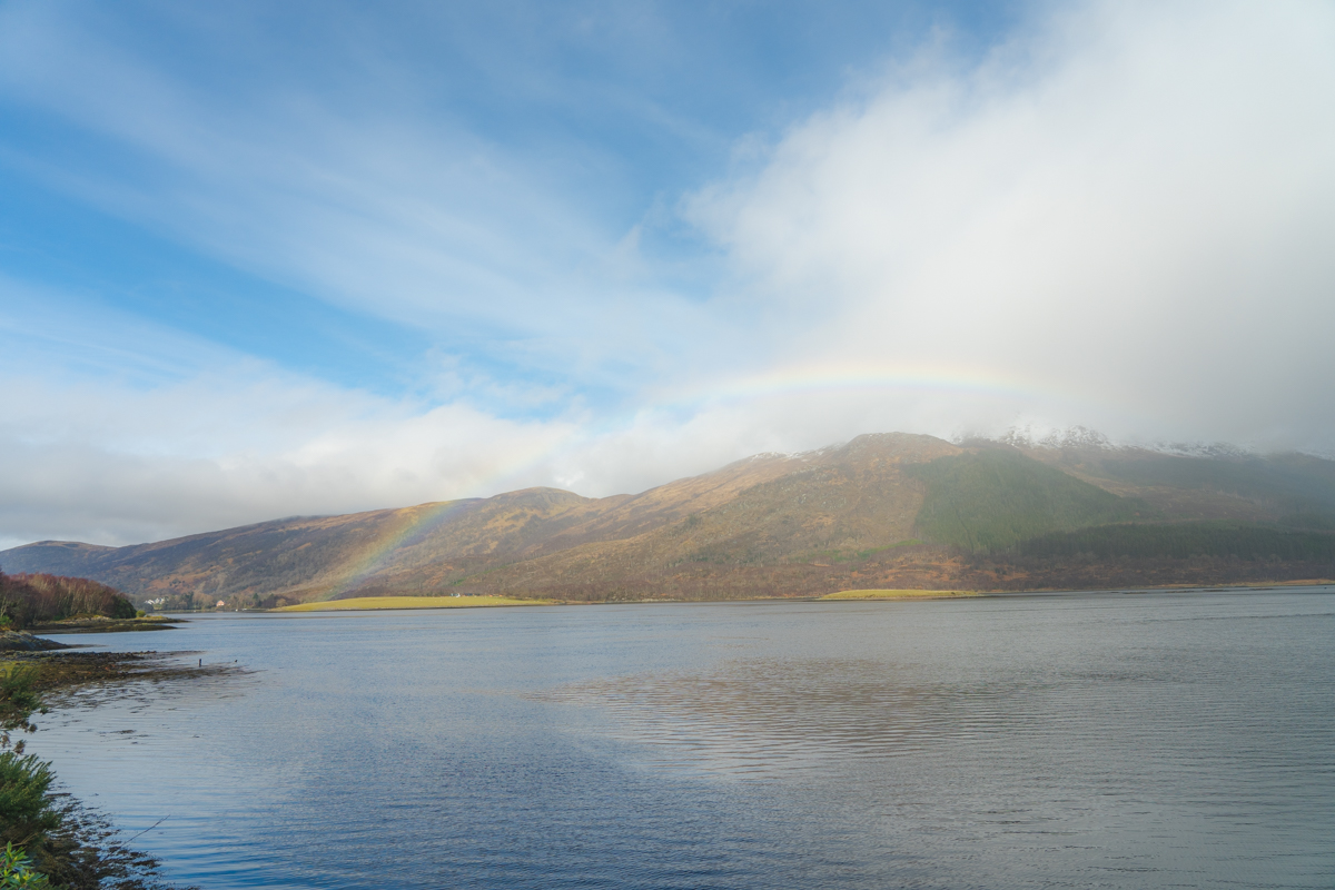 rainbow over loch in scotland highlands