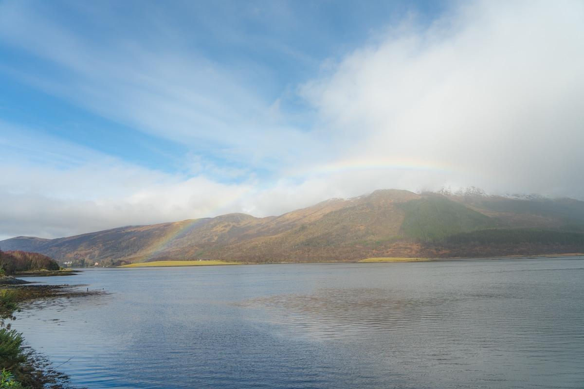 rainbow over loch in scotland highlands